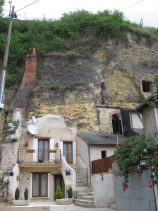 This house built into a rock face is in France across from Leonardo Da Vinci's house.