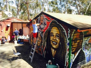 We took time this month to stop at the Che Cafe to help paint. A good friend of ours is leading the effort to save the building for demolition. They invited Sean to come paint with the muralist Mario Torero, http://www.fuerzamundo.org/paintings/murals/