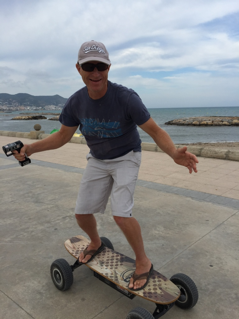 Jim chose an electric skateboard. The power comes from a lithium battery. He is holding the variable speed controller for  in his hand.